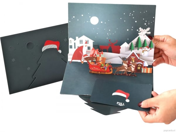 Popcards.nl Christmas card Santa sleigh Christmas houses with deer and snowman
