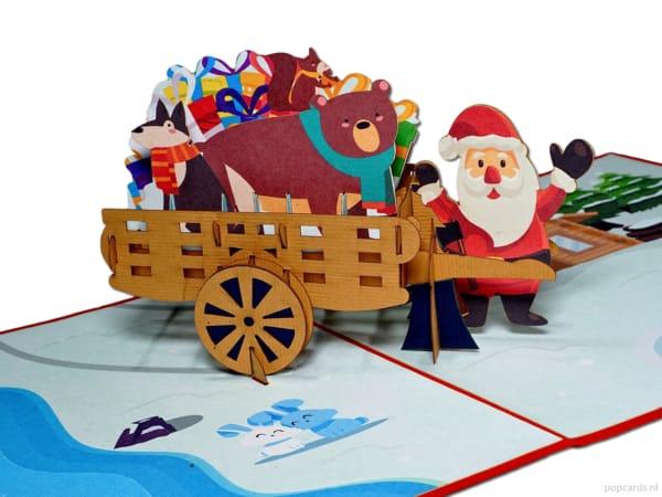 Popcards popupkaarten – vrolijke kerstman met handkar kar vol cadeautjes leukste kerstkaart pop-up kaart